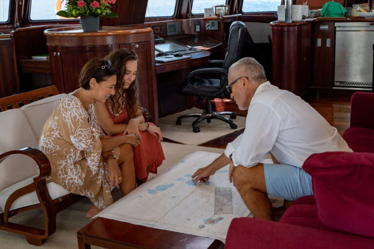 Super yacht DOUCE FRANCE - guests looking at map