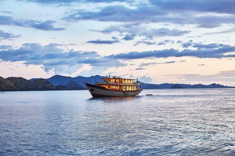 Mischief custom Phinisi Yacht by sunset