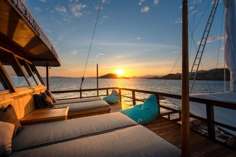 Luxury Phinishi Yacht ORACLE Lounge by sunset