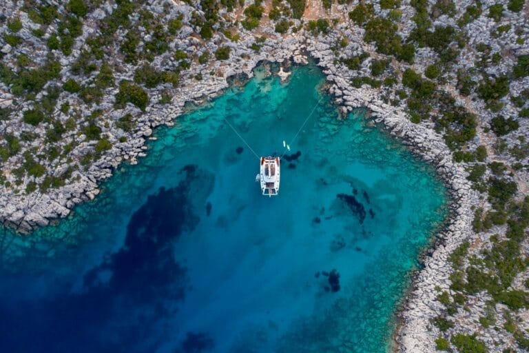 Luxury Catamaran Serenissima at anchor in a beautiful bay