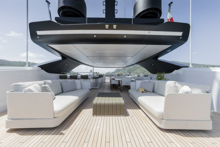Flybridge cooles yacht ever SEVEN SINS spacious deck for charter loung and dining white and grey design