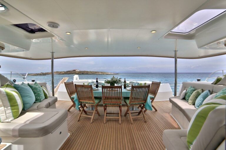 Outdoor dining on catamaran Fountaine Pajot WORLDS END during charter holiday in Greece