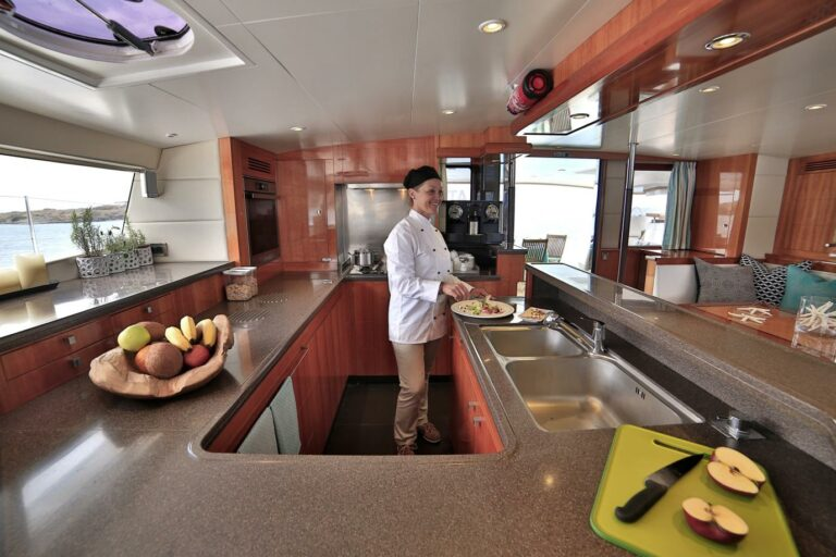 Great food coming from chaf cook in spacious galley of catamaran on top deck on WORLDS END Charter yacht