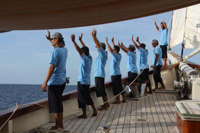 Crew of MUTIARA LAUT waiving at passengers charter Indonesia